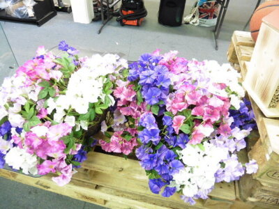 2 hanging baskets of artificial flowers