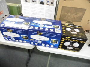 2 Sunforce solar motion activated lights and a night watch twin security light with boxes